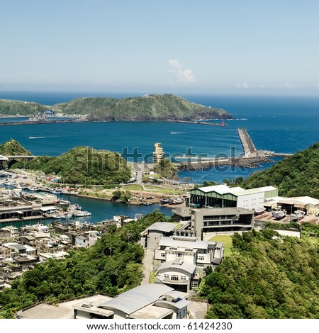 Attractive harbor scenery with blue ocean and sky in Taiwan. - stock photo