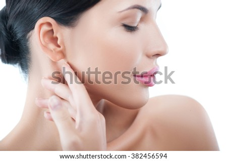Attractive healthy woman prefers skincare treatment