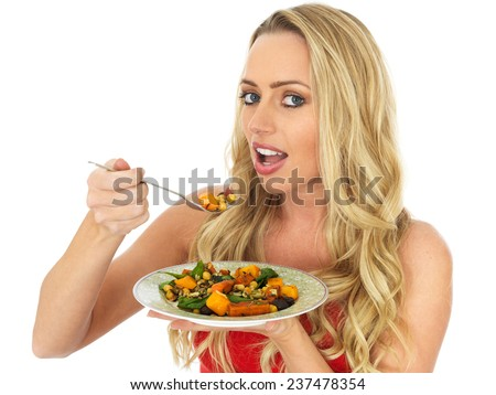 Attractive Healthy Young Woman Eating a Roast Vegetable Salad