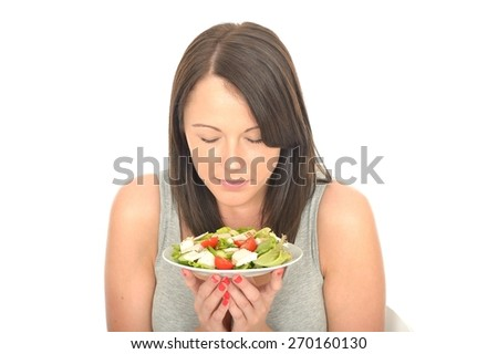 Attractive Healthy Young Woman Holding a Plate of Chicken with Mixed Fresh Salad