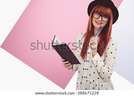 Attractive hipster woman writing on notepad against rosa and white - stock photo