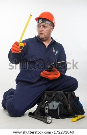 Attractive hispanic construction worker - stock photo