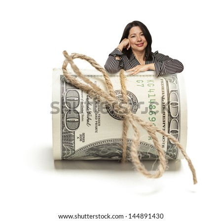 Attractive Hispanic Woman Leaning on a Roll Of One Hundred Dollar Bills Isolated on a White Background. - stock photo