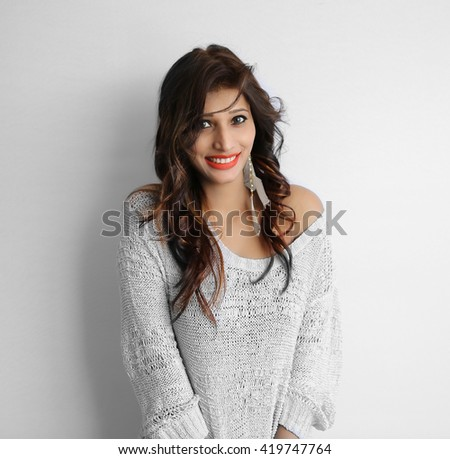Attractive indian brunette woman isolated on white background - stock photo