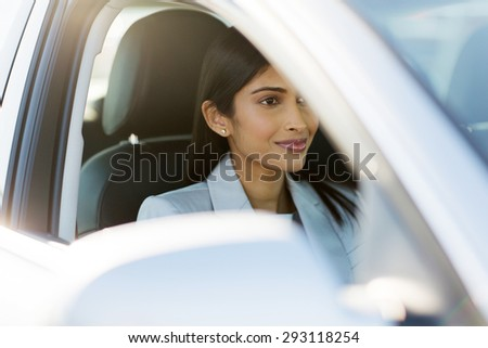 attractive indian businesswoman drive to work - stock photo