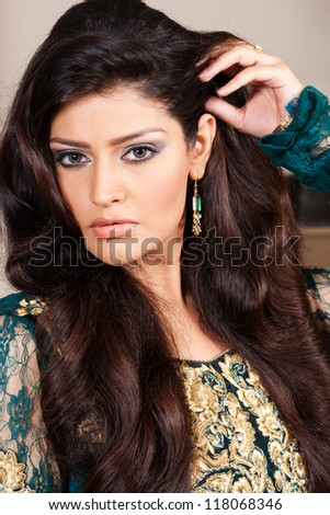 Attractive Indian Girl With Beautiful Long Hair, Female Fashion Model  Posing For The Camera