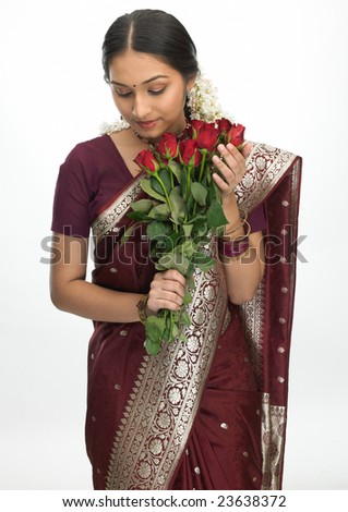 Attractive indian girl with  bunch of red roses - stock photo