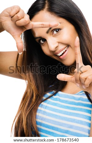 attractive Indian woman framing photograph fingers - stock photo