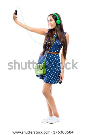 Attractive Indian woman taking selfie self portrait fashion model white background