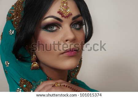 attractive indian women close up portrait shot in the studio