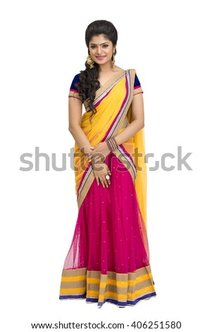 Attractive Indian young girl in traditional half sari isolated on white. - stock photo