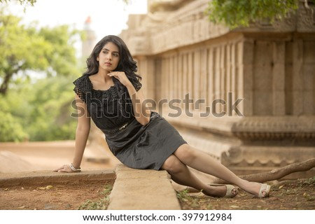 Attractive Indian young women posing with temple background. - stock photo