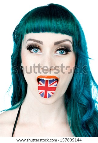 attractive interesting looking woman with tongue in shape of united kingdom flag - stock photo