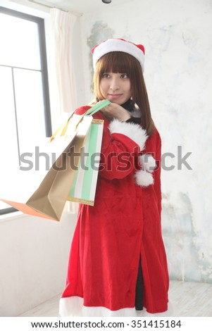 Attractive Japanese Young Woman wears Santa Claus Costume