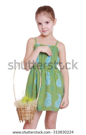 Attractive kid holding spring basket with Easter eggs isolated over white background - stock photo