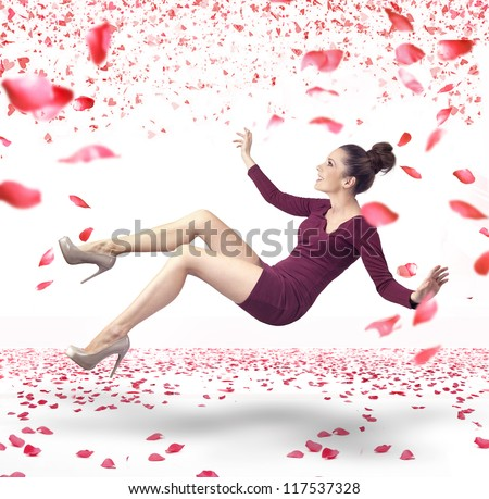 Attractive lady falling down over rose petals background - stock photo