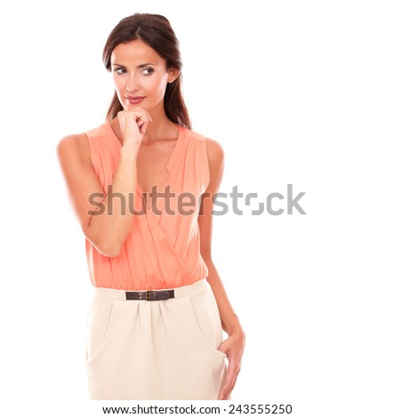 Attractive lady in elegant skirt wondering while looking to her left and with hand on chin in white background - copyspace - stock photo