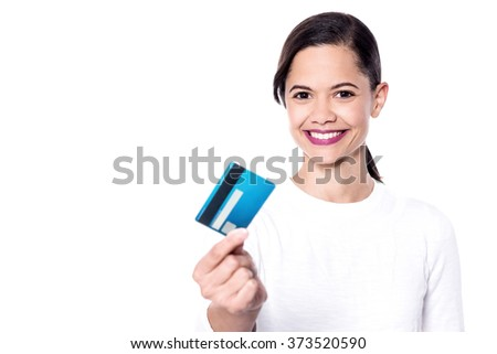 Attractive lady showing credit card and smiling at camera