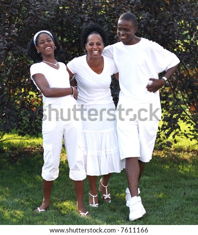 attractive, laughing African-American family outside in backyard - stock photo