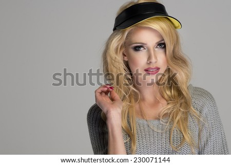 Attractive long haired beautiful woman with cap  - stock photo