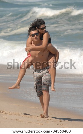 attractive lovely couple on the beach