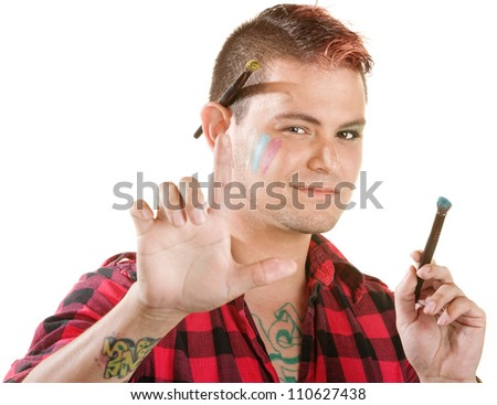 Attractive makeup artist with brushes over white background - stock photo
