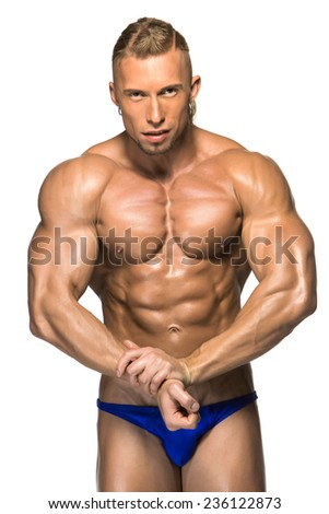 Attractive male body builder, isolated on white background