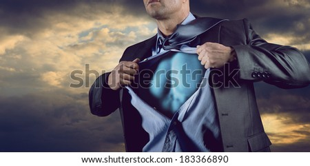 Attractive male businessman stripping off shirt and showing his muscular chest. - stock photo