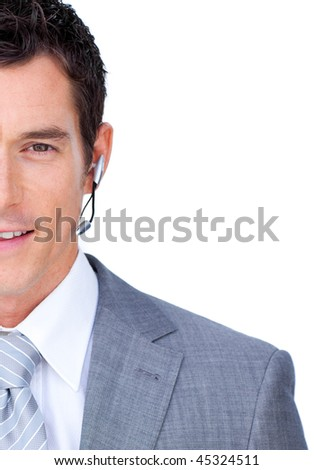 Attractive male executive with headset on against a white background - stock photo