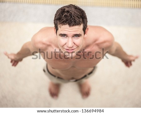 Attractive male model. Close-up smiling man's face. - stock photo