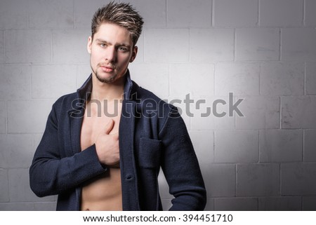 Attractive male model - Handsome young man - Fashionable shirtless hunk wearing a blue jacket, blazer - stock photo