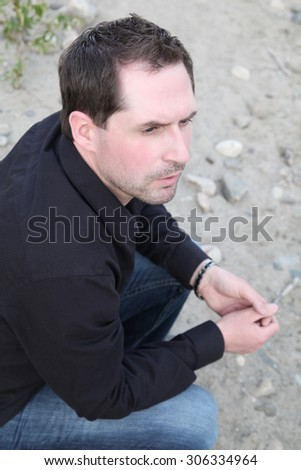 Attractive male model outdoors at the beach - stock photo