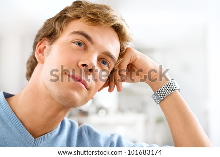 Attractive male university student planning ahead thinking of th - stock photo