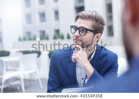 Attractive male workers are meeting in cafe - stock photo