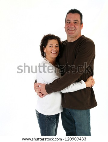 Attractive man and woman standing together on white background