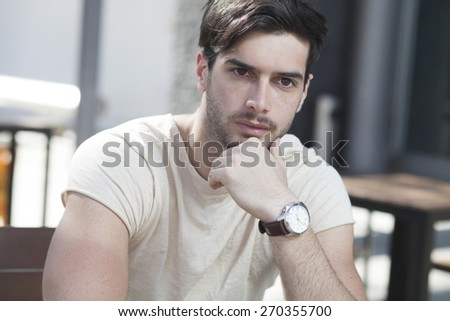 Attractive man deep in contemplation - stock photo
