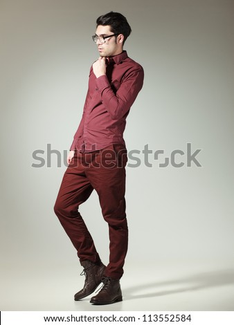 attractive man dressed casual-elegant posing in the studio (full body) - stock photo
