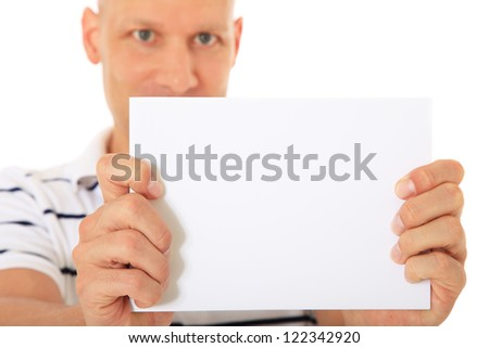 Attractive man holding blank white placeholder. All on white background. - stock photo