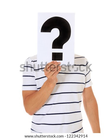 Attractive man holding question mark in front of his head. All on white background. - stock photo