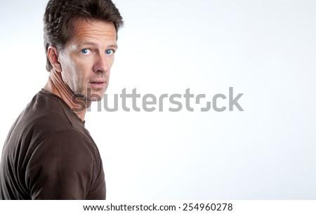 Attractive man is looking over his shoulder - stock photo