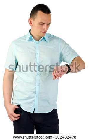 Attractive man looking at his watch isolated on white - stock photo