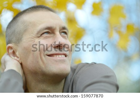 attractive man out for a walk in the early autumn - stock photo