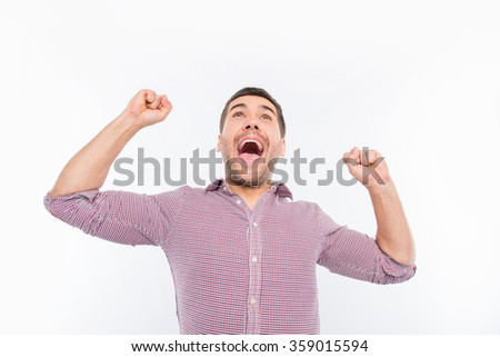 Attractive man screaming and showing fists