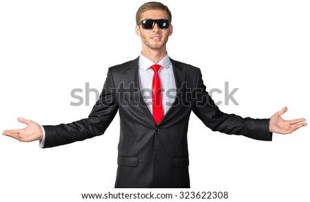 Attractive man shows a sign of peace or victory - stock photo