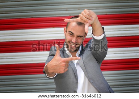 Attractive man standing on subway striped background - stock photo