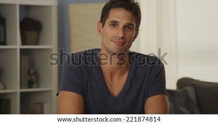 Attractive man talking to camera - stock photo