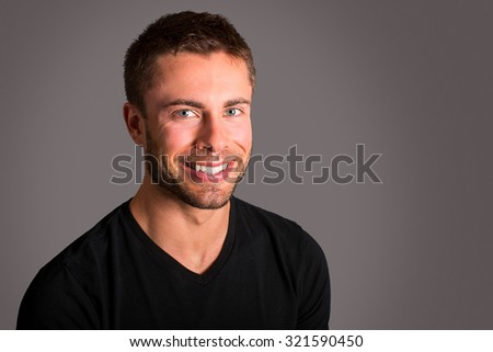 Attractive man wearing a black tshirt - stock photo