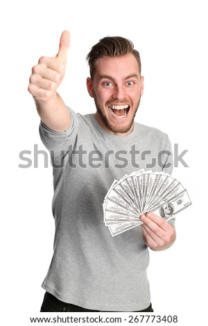 Attractive man wearing a shirt, holding a fan of dollar bills in front of him. White background. - stock photo