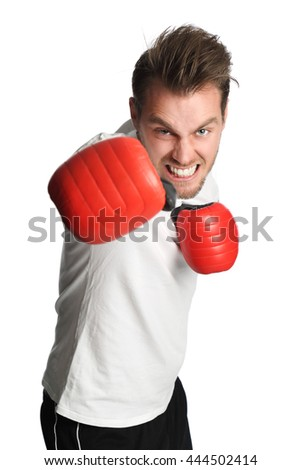 Attractive man wearing a white tshirt and black shorts with red boxing gloves, punching. White background.