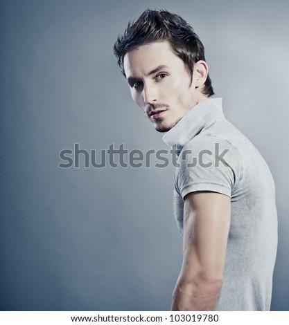 Attractive man wearing T-shirt. - stock photo